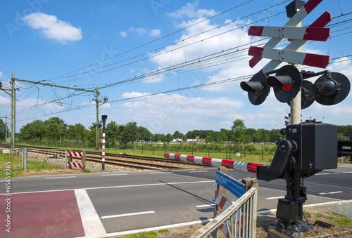 Fotografia, Obraz  Closed barriers of a rail crossing