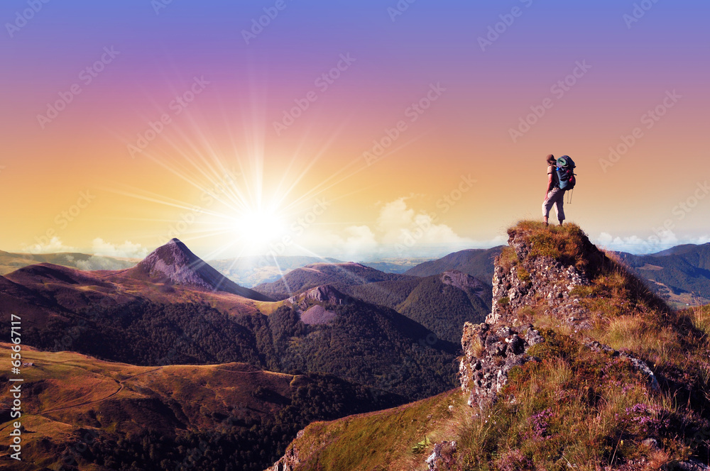 Fototapety, obrazy: hiker on top of a rock looking far away