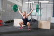 Woman trains squats at crossfit center