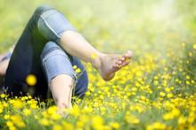 Woman Lying In Meadow Relaxing