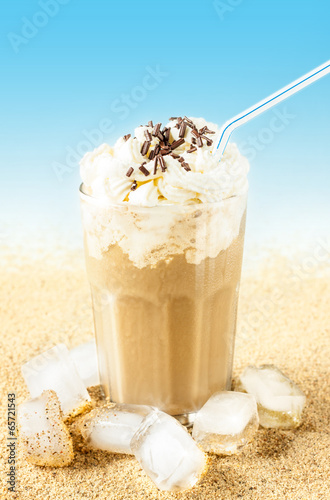 Frappe - iced coffee on beach background - 65721543