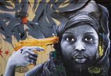 Fototapeta Młodzieżowe - Graffitti on a metallic surface with a human face