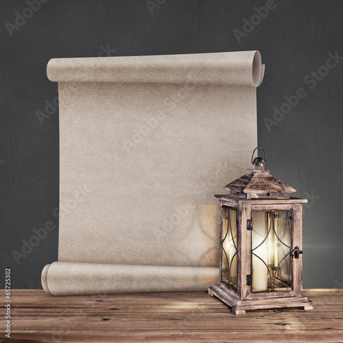 Photo vintage lantern with antique scroll on gray background