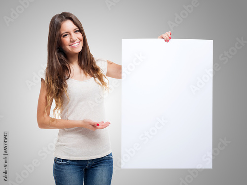 Valokuva  Woman showing a white board