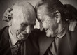 Leinwandbild Motiv Cute 80 plus year old married couple posing for a portrait