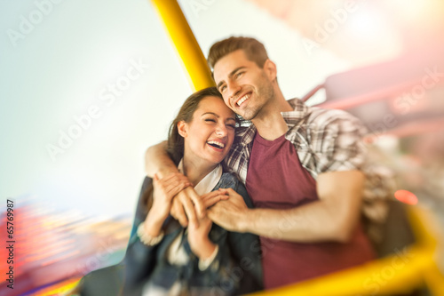 Poster Amusementspark couple playing shooting games while visiting an amusement park