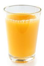 Single Glass Of Orange Juice On A White Surface