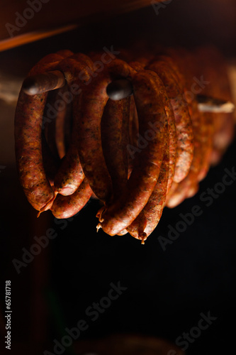 Staande foto Vlees Traditional food. Smoked sausuages in smokehouse.