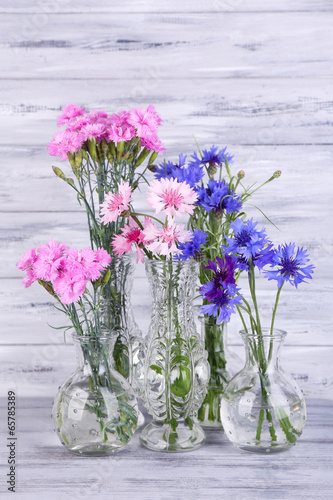 Beautiful Summer Flowers In Vases On Grey Wooden Background Buy