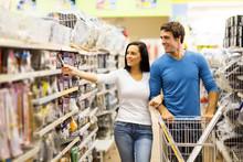 Young Couple Buying Padlock