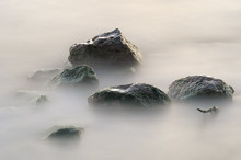 Wet Stones In The Lake.