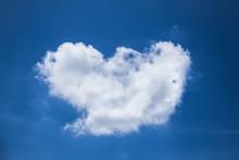 Cloud  Heart Shaped On Deep Blue Sky Background
