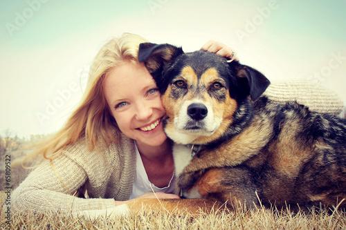 Smiling Woman Hugging German Shepherd Dog