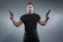Action Hero Muscled Man Holdin...