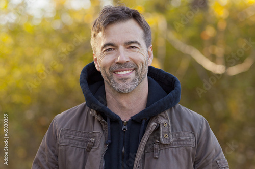 Fotografia  Portrait Of A Mature Man Smiling