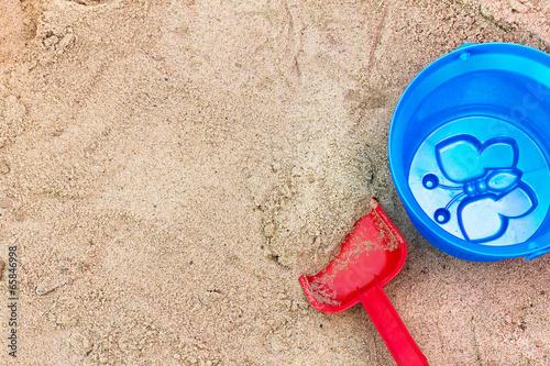 Photo  Children's toys in the sandbox.