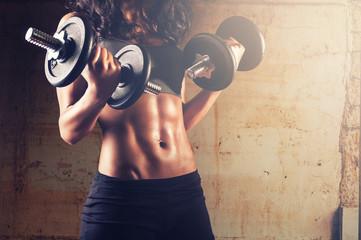 Fototapeta samoprzylepna Strong body woman workout