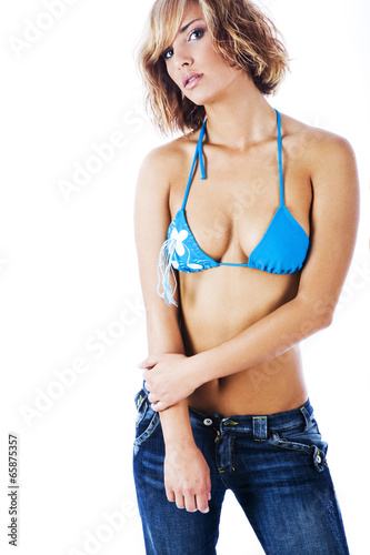 9eab77efac74 Sexy girl wearing bikini top and jeans - Buy this stock photo and ...