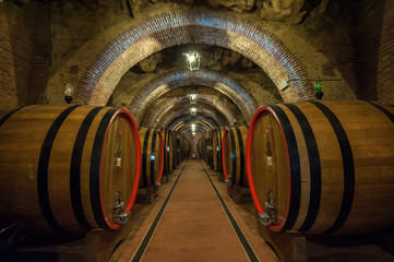 Fototapeta Wine barrels (botti) in a Montepulciano cellar, Tuscany