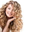 Leinwanddruck Bild - Beauty girl with blonde curly hair.  Long permed hair