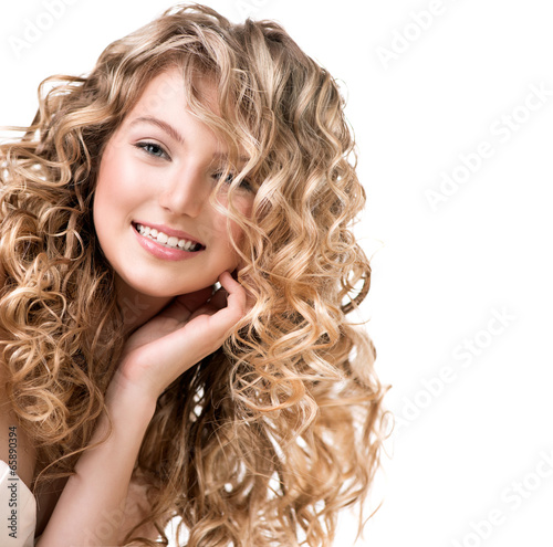 Carta da parati Beauty girl with blonde curly hair.  Long permed hair