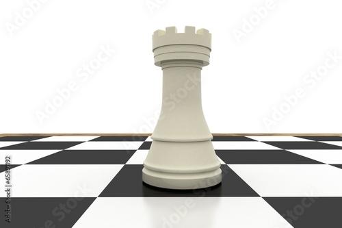 Valokuva  White rook on chess board