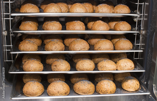 Rye bread rolls baked in the oven - 65898319