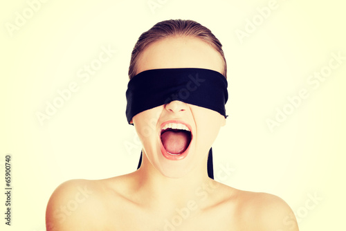 Fotografie, Obraz  Blindfold woman screaming