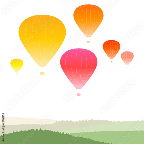 Hot air balloons over green landscape