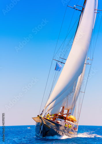 Poster Zeilen A big 3 mast classic sailing boat in Spetses island in Greece