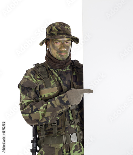 Canvas Prints Military Soldier pointing finger to white blank board