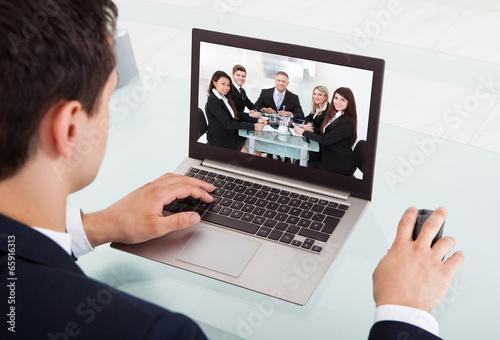 Fototapeta Businessman Video Conferencing On Laptop In Office obraz na płótnie
