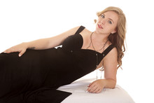 Woman Black Dress Lay On Side Serious