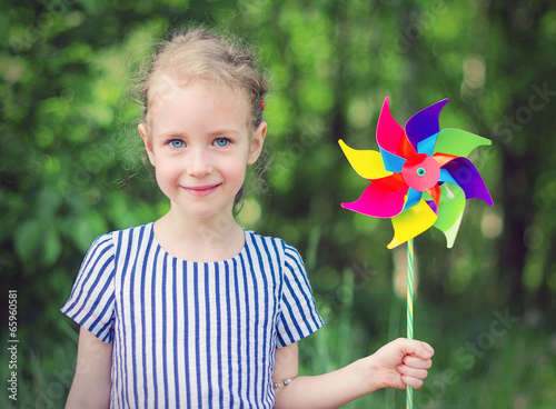 Fotografia, Obraz  Little girl with colorful pinwheel in the park.