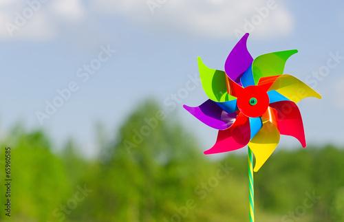 Fotografia, Obraz  Childish pinwheel against blue sky background.