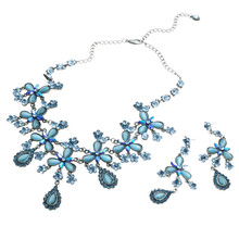Necklace And Ear Rings With Blue Gems Isolated On White