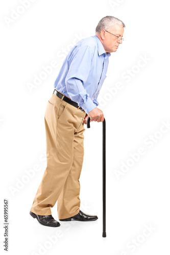 Old man walking with cane Fototapeta