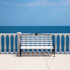 Fototapetawhite bench and balustrade overlooking the sea