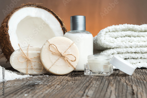 Fotografering  Bars of soap, coconut and face cream-spa setting
