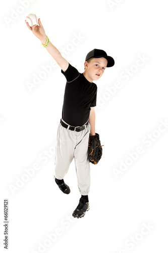 Fotografie, Obraz  young boy in uniform pitching a baseball right handed
