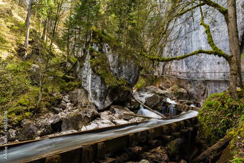 Spoed Fotobehang Onweer Wasserlauf in der Pöllatschlucht im Allgäu