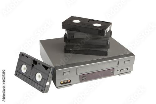 Valokuvatapetti stack of videotapes on videorecorder isolated on white