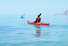 Kayak. People Kayaking In The Ocean. Active People. Sport