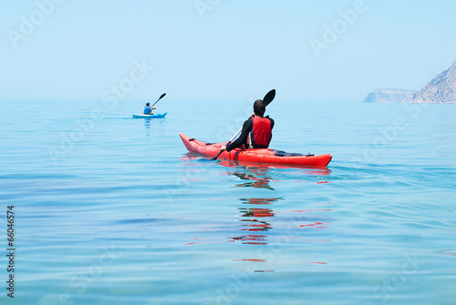 Valokuva  Kayak. People kayaking in the ocean. Active people. Sport