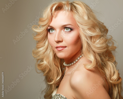 Portrait of beautiful woman with elegant hairstyle.