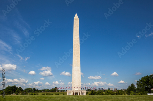 Fotografie, Obraz  Side view of the Washington monument and the ring of American fl
