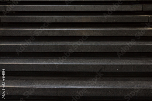 Straight look at a black stone stair case