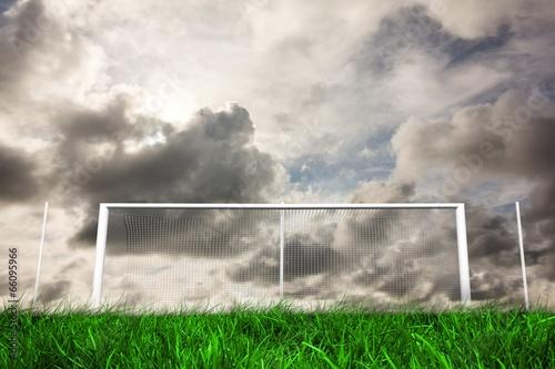 Fotografia, Obraz  Football goal under grey cloudy sky