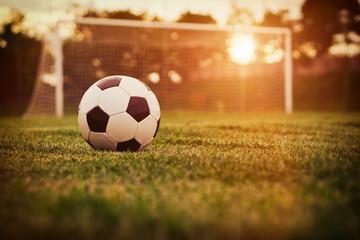 Fototapeta piłka nożna zachód słońca