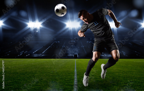 Photo  Hispanic Soccer Player heading the ball